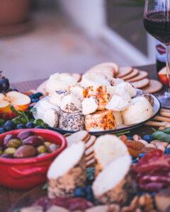 Hanini Gbejniet, wine, olives, salami. A great cheese board!